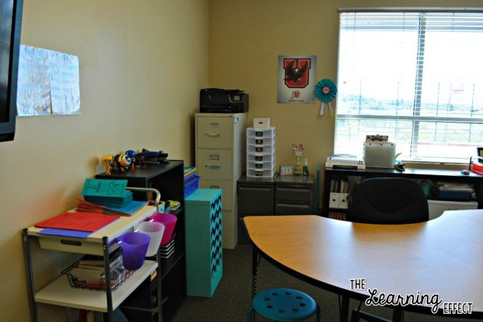 teacher table and filing cabinets in classroom